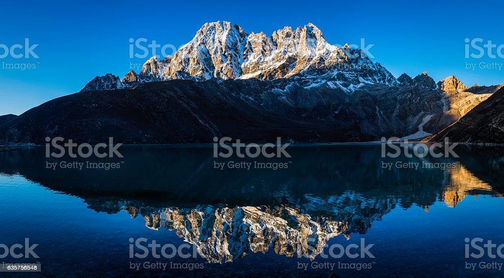 Snowy mountain peaks panorama reflecting Gokyo Lake Pharilapche Himalayas Nepal stock photo