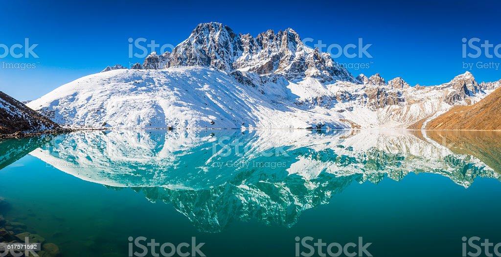 Snowy mountain peaks Phari Lapcha reflecting Gokyo Lake Himalayas Nepal stock photo