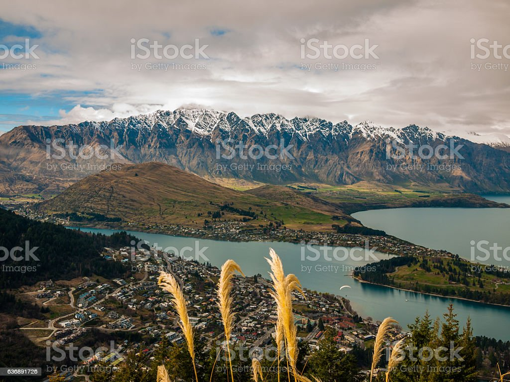 Snowy mountain range with a town and lake stock photo