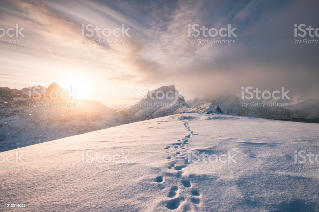 Snowy mountain ridge with footprint in blizzard – zdjęcie