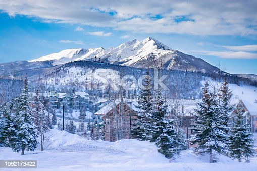 Beautiful  Colorado mountain town in winter. Snowcapped mountains and houses. Silverthorne, Colorado, USA