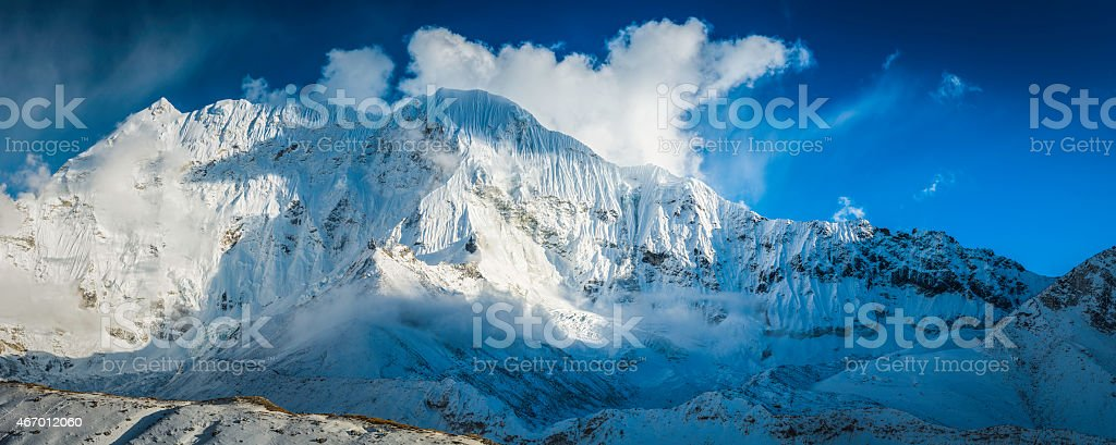 Snowy mountain wilderness Himalaya peak panorama dramatic fluted glaciers Nepal stock photo
