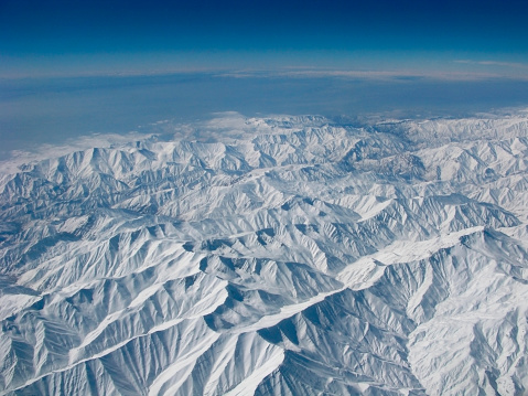 istock Snowy mountains aerial view 513045512