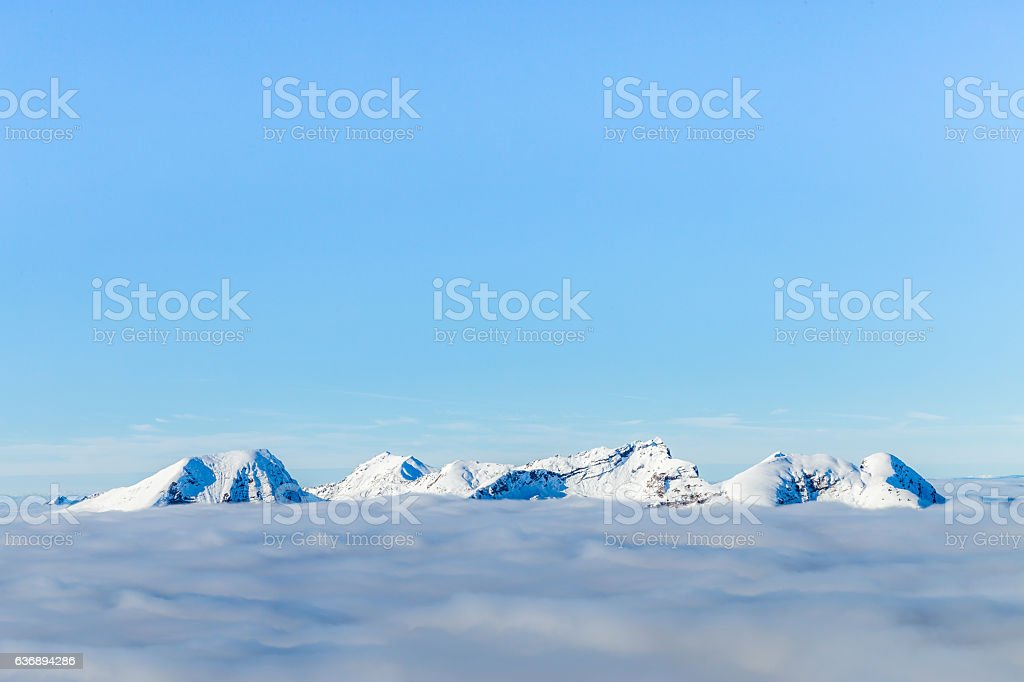 Snowy mountains and clouds - Photo