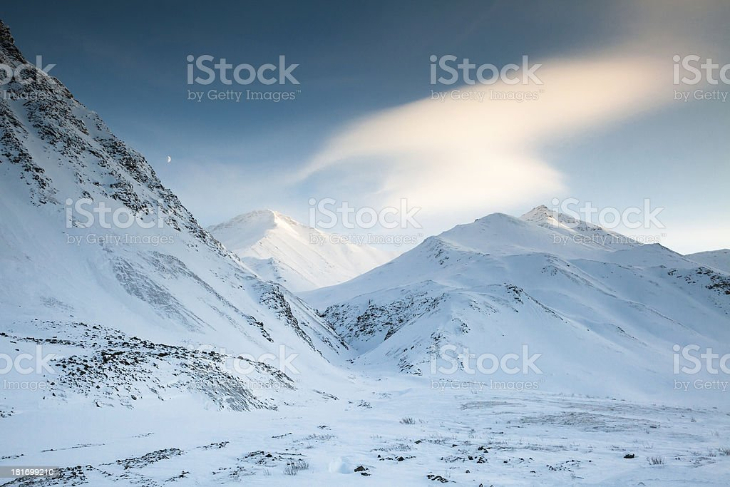 Snowy Mountains - Moon Over the Brooks Range, Alaska royalty-free stock photo