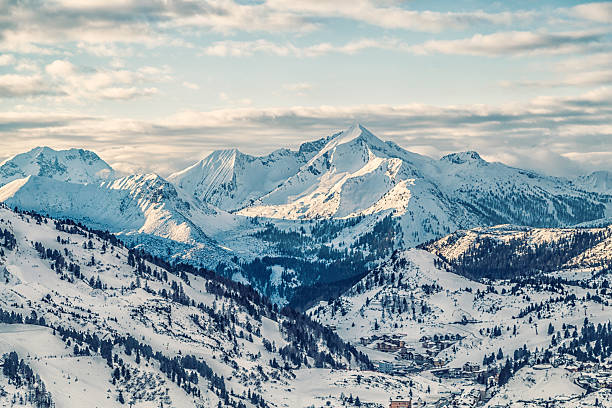 snowy mountains - rocky mountains stock photos and pictures