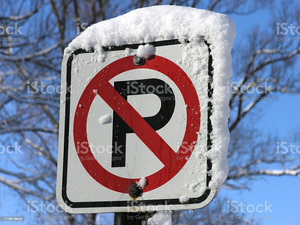 Snowy No Parking Sign stock photo