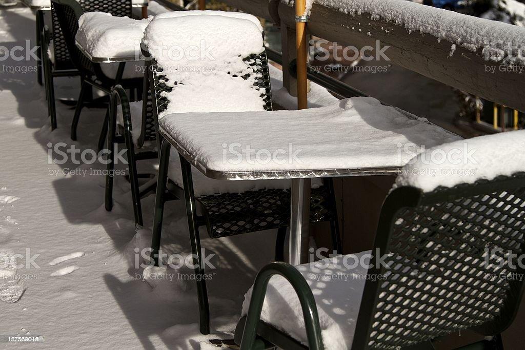 Snowy patio furniture royalty-free stock photo