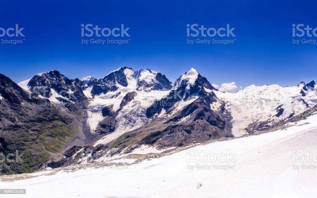 Snowy peaks Bernina range stock photo