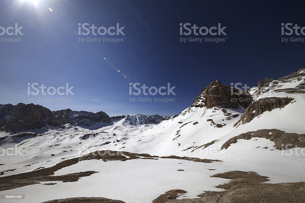 Snowy plateau and blue sky with sun royalty-free stock photo