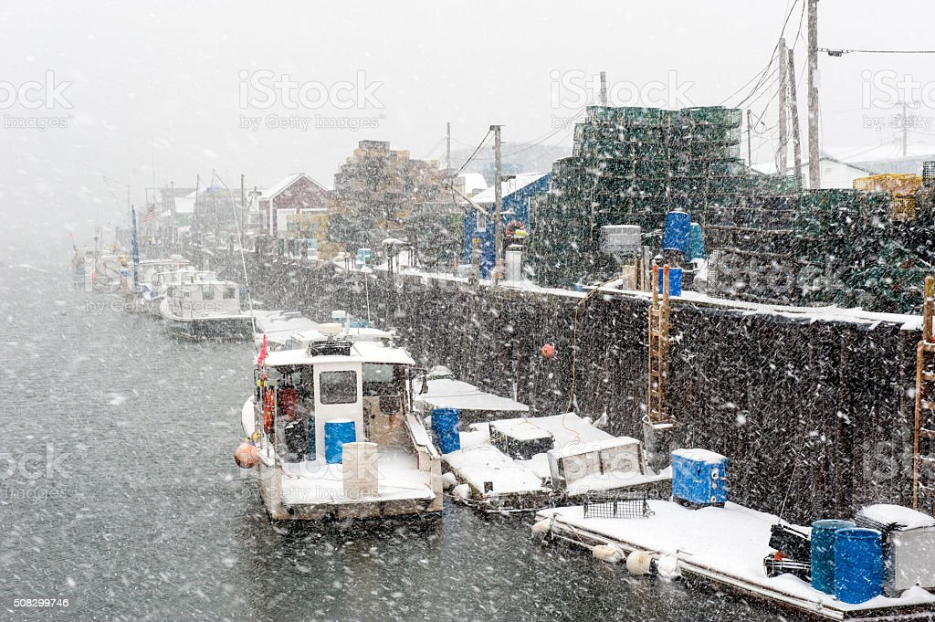 Snowy Portland, Maine harbor with lobster boats during a blizzard stock photo
