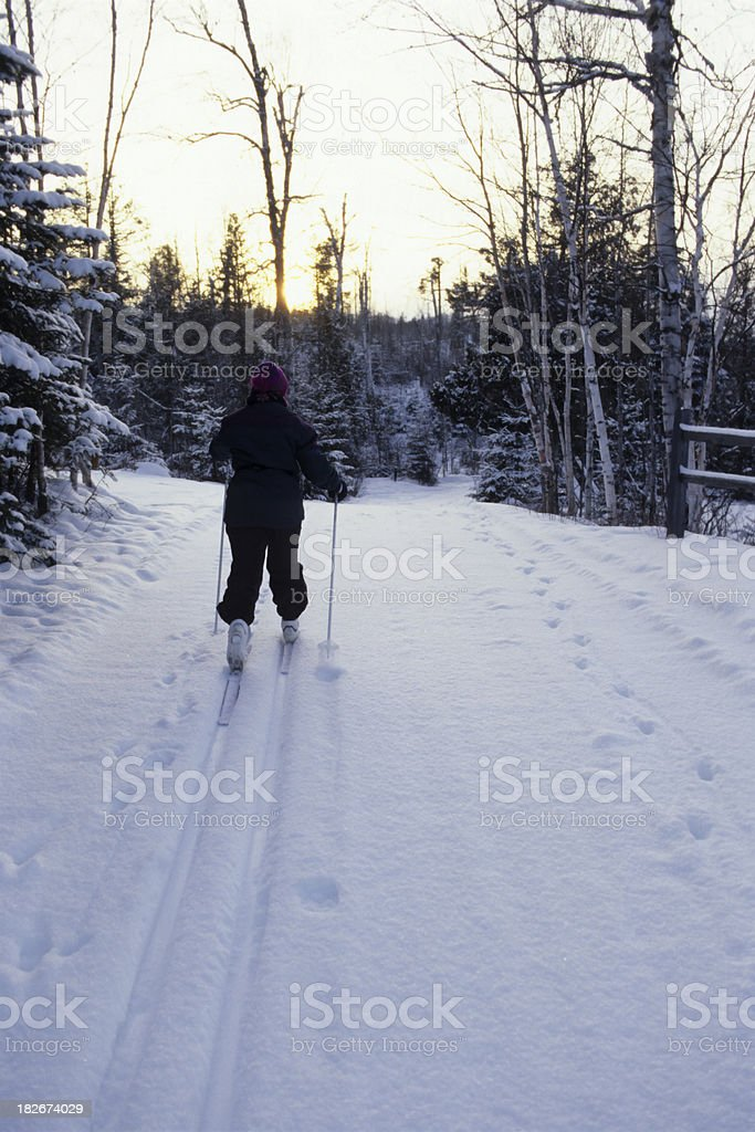 snowy road and cross-country skier royalty-free stock photo