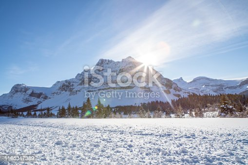 Scenic View Of snowy road in the Canadian Rocky Mountains Against Sky in winter