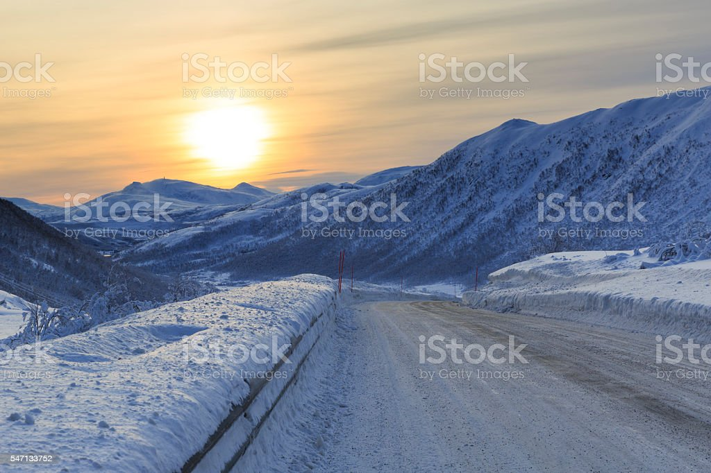 Snowy road on Senja Island stock photo