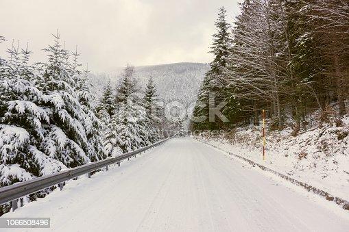 1066508460 istock photo Snowy road 1066508496