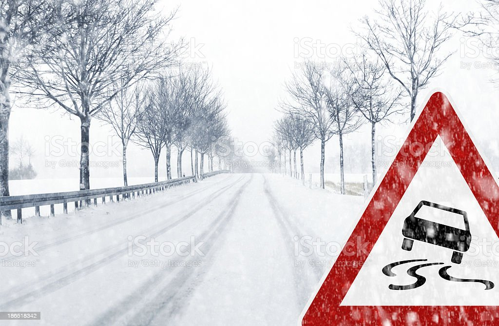 Snowy road with traffic sign royalty-free stock photo