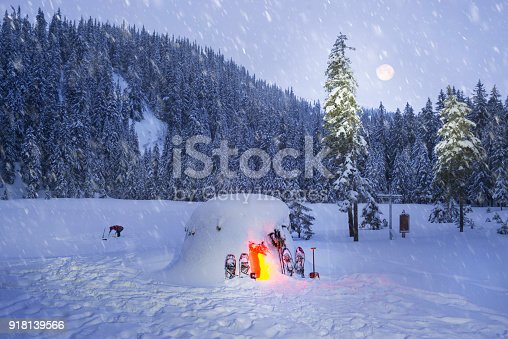 new year, tourists, extreme travelers, built a snow house on the shore of the mountain lake Maricheyka under the mountain Pip Ivan Carpathians  had fun here on a holiday weekend in a frosty trip