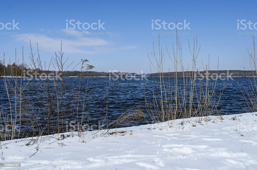 Snowy shore of Glienicke lake on Havel river royalty-free stock photo