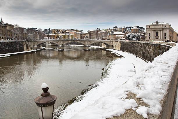 Snowy shore of the Tiber river, Rome (Italy). stock photo