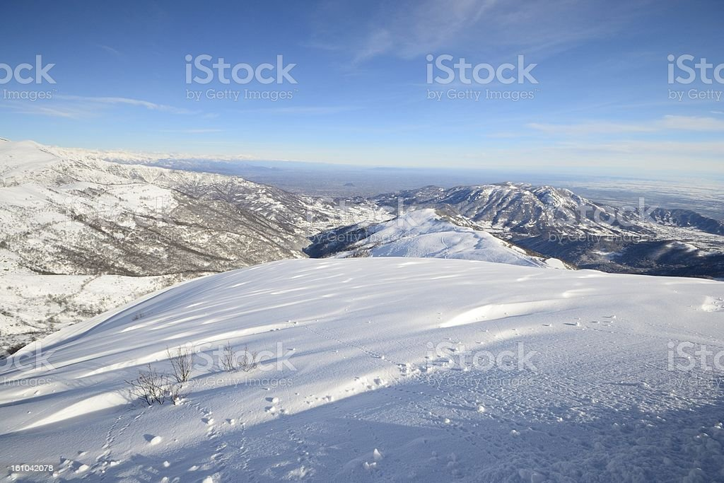 Snowy slope with panorama royalty-free stock photo