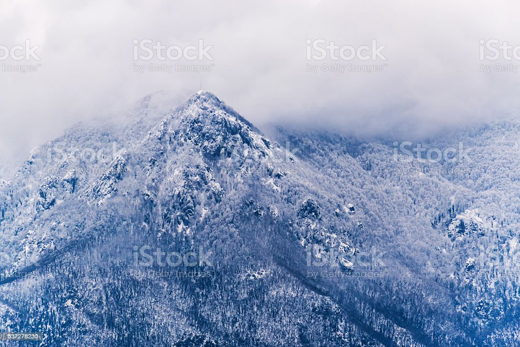 Snowy stormy mountain side toned stock photo