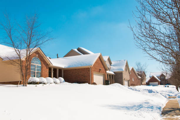 Snowy street in american suburbs winter scenery picture id887781472?b=1&k=6&m=887781472&s=612x612&w=0&h=0gwm1c6tu5jium7khbq 4d4gxyapluiizrxaedkkguo=