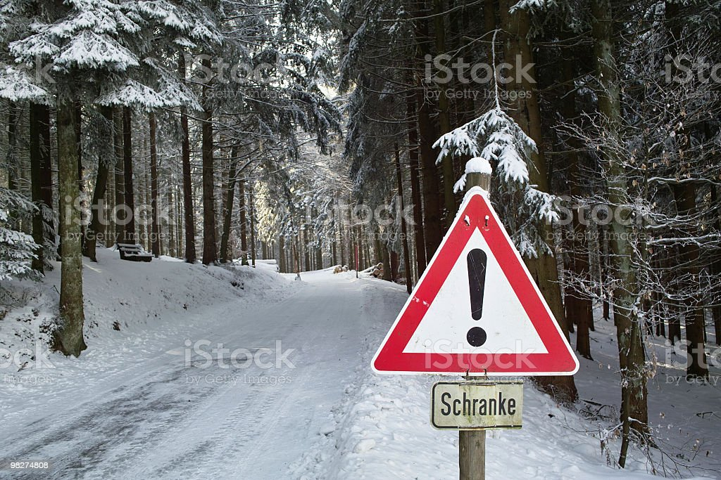 snowy street with attention sign in winter royalty-free stock photo