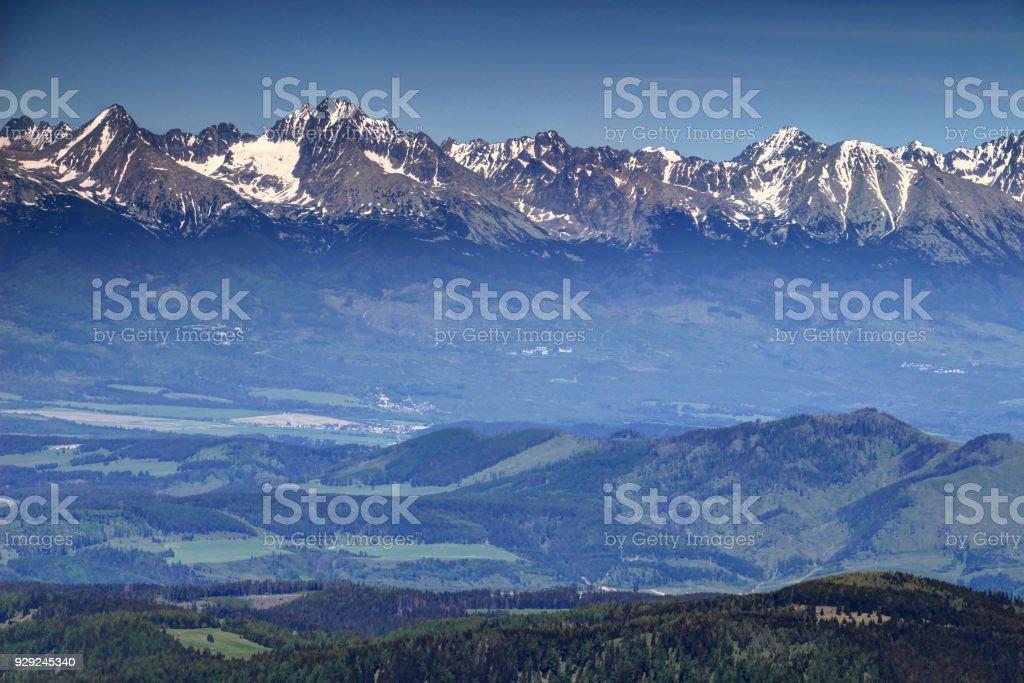 Snowy Tatra peaks, green valleys and hills in spring Slovakia stock photo