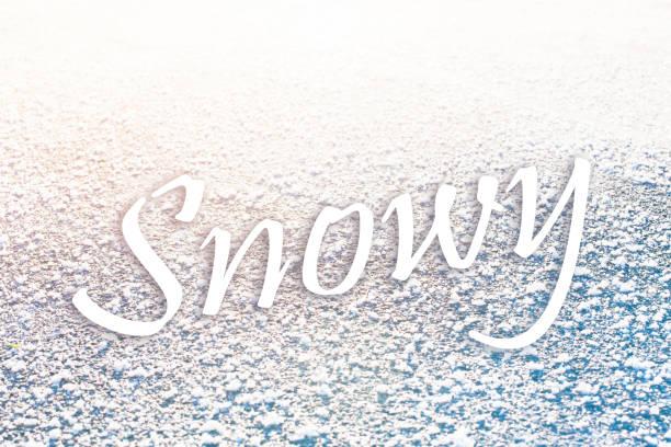 Snowy text on frozen stock photo
