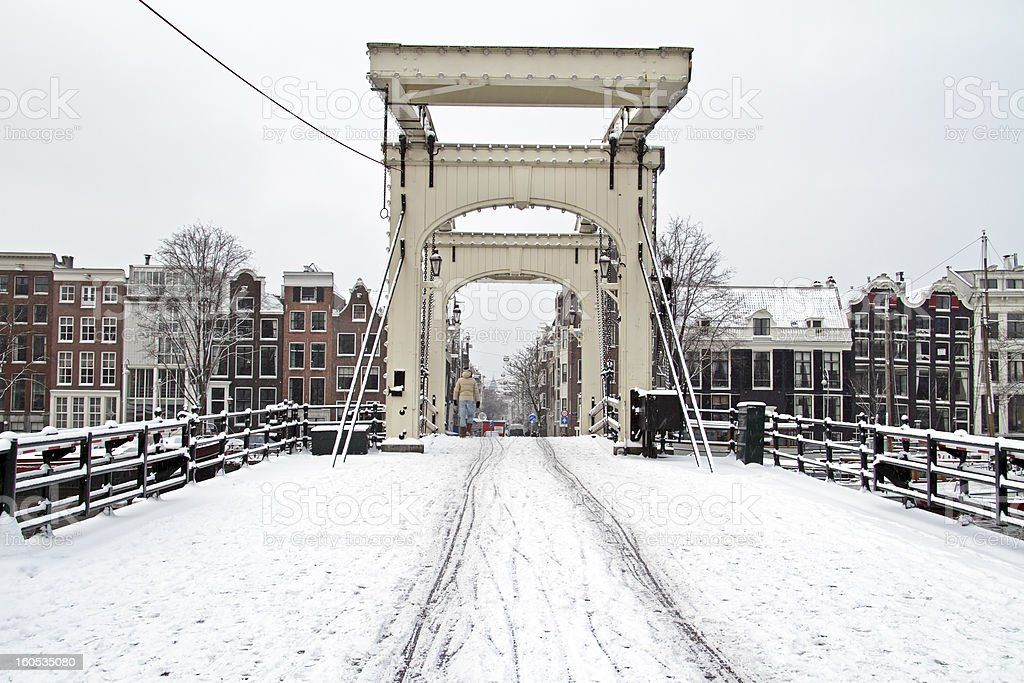 Snowy Thiny bridge in Amsterdam the Netherlands stock photo