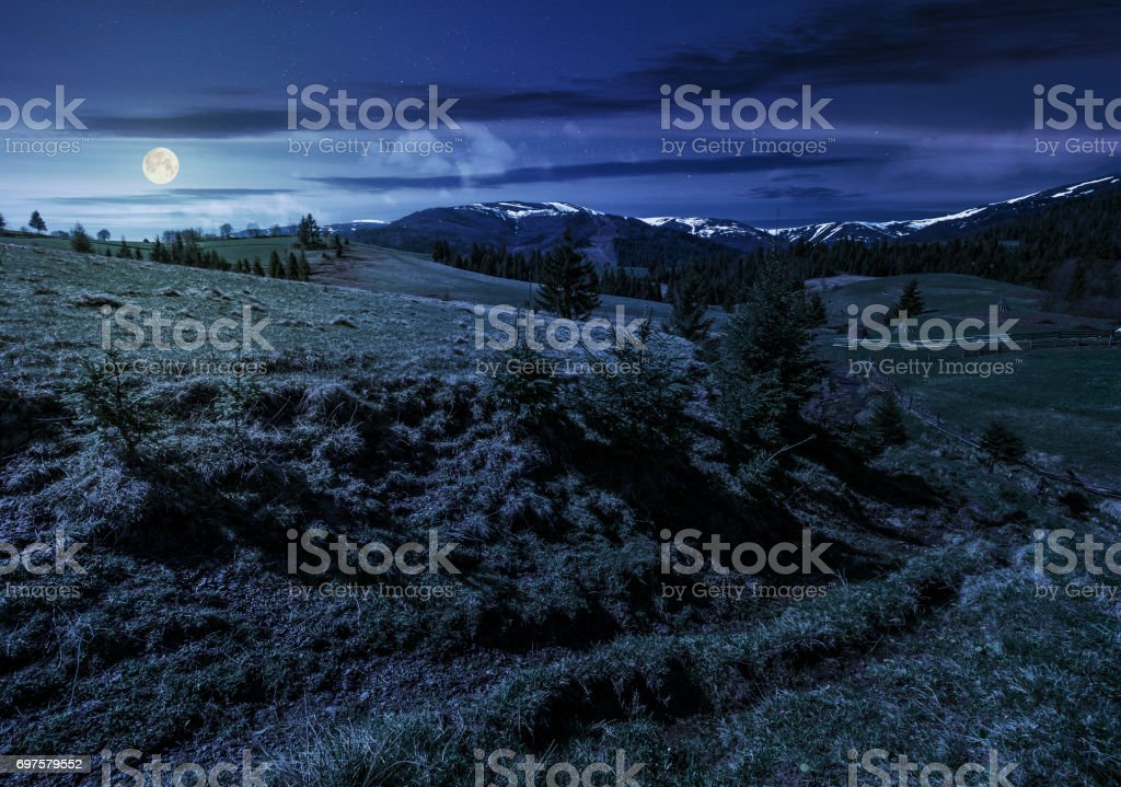 snowy tops of carpathians in springtime at night stock photo