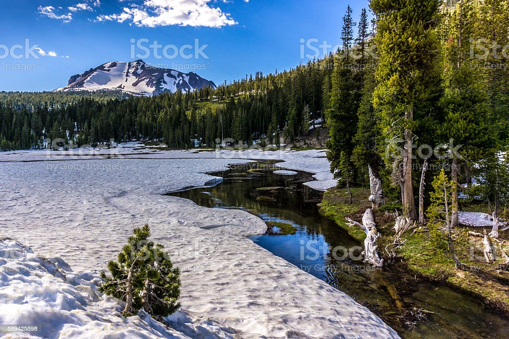 Snowy Upper Meadow, Kings Creek and Lassen Peak stock photo