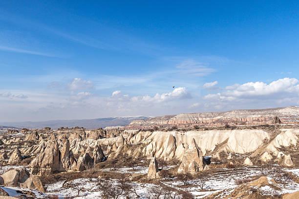 Snowy valleys of Cappadocia in early spring stock photo