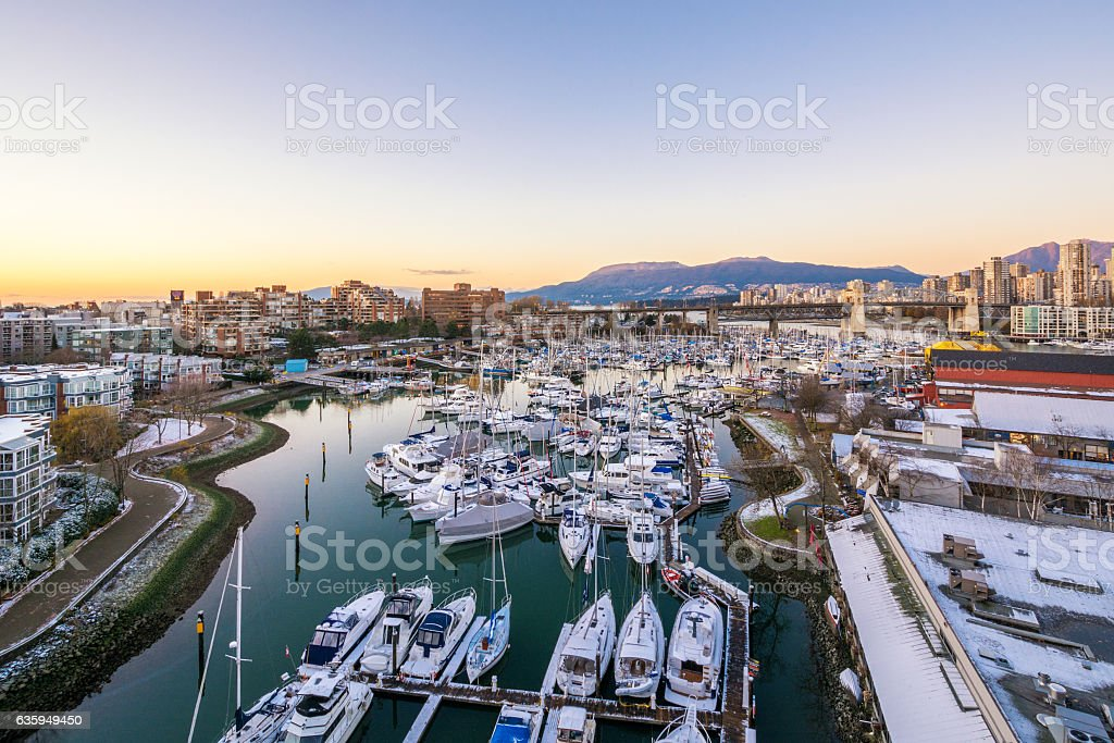 Snowy view of Granville Island. Downtown skyline in Vancouver, Canada. stock photo