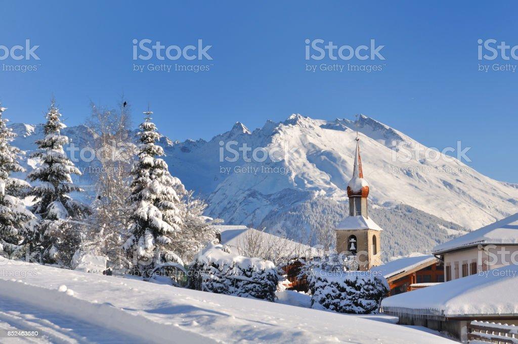 snowy village in mountain stock photo