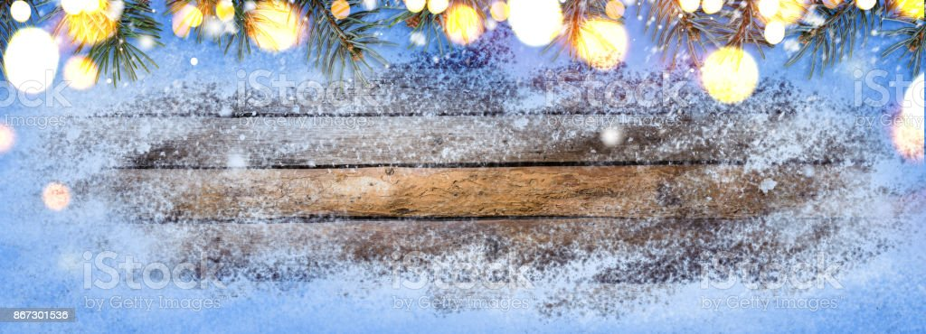Snowy vintage wooden table stock photo