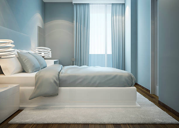 snowy weißen bett in blau schlafzimmer - teppich hellblau stock-fotos und bilder