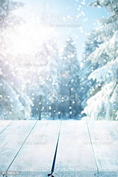 Snowy winter background with empty wooden planks picture id611880576?b=1&k=6&m=611880576&s=612x612&h=xekqnowqyrt7c8ufvjuewlaqh6aysi65xmplrcioqyo=