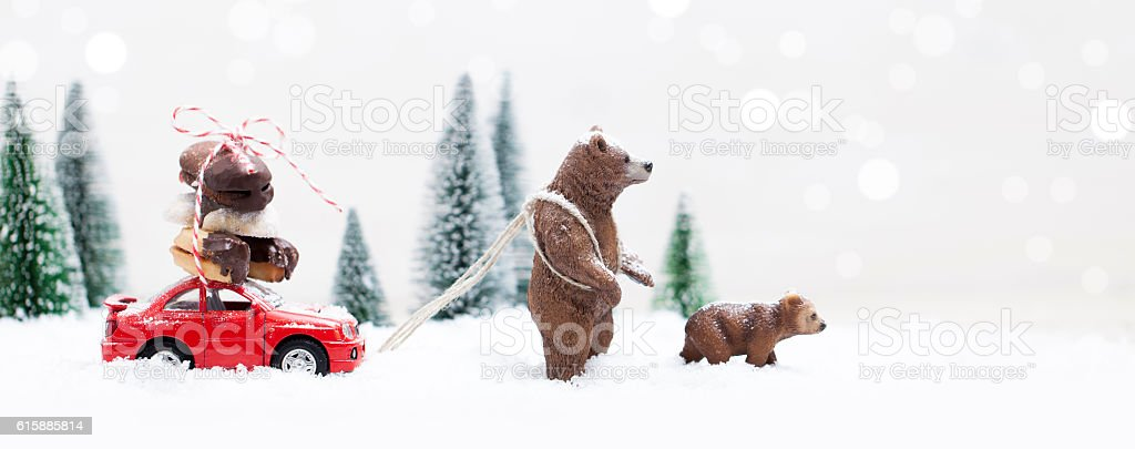 Snowy Winter Forest with a grizzly bear and red car stock photo