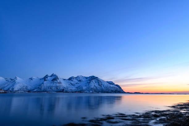 Snowy winter landscape sunset in the Lofoten in Norway stock photo