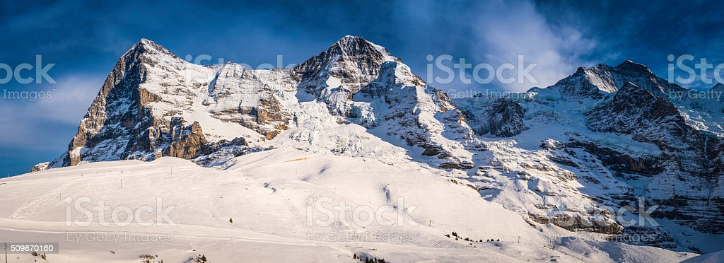 Snowy winter mountain peaks panorama Eiger North Face Alps Switzerland stock photo