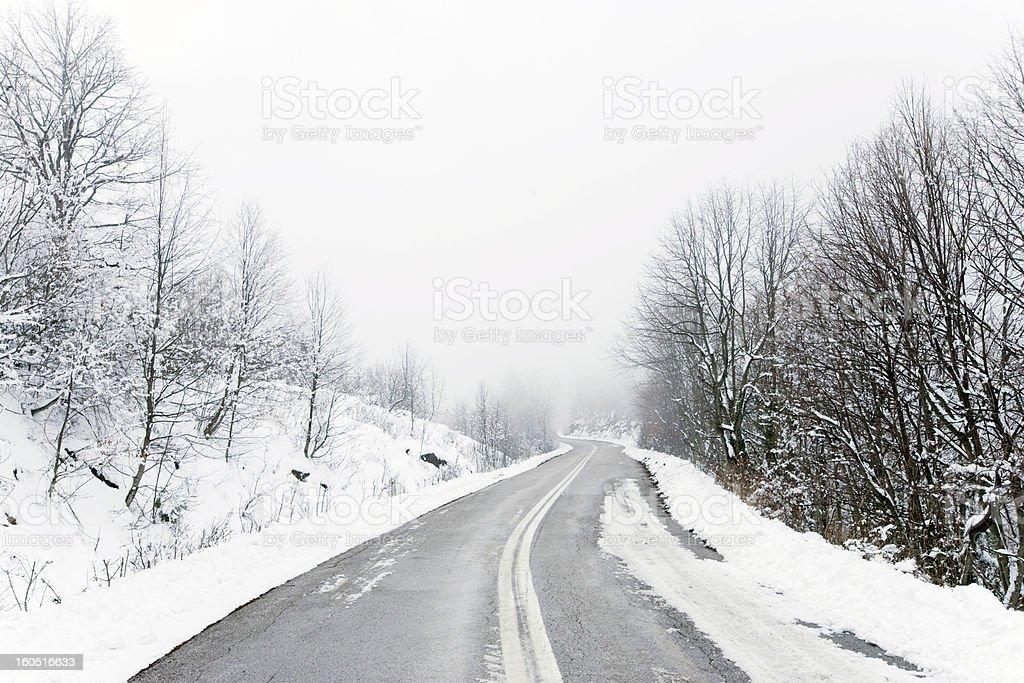 Snowy winter road royalty-free stock photo