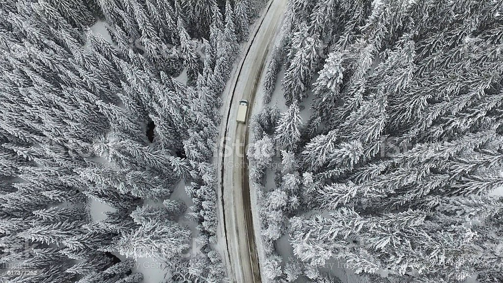 Snowy Winter Road with a Car stock photo