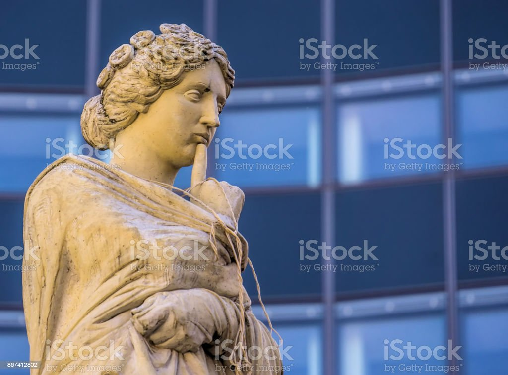 Snug muse hung with rope in front of the Augustineum of the University of Leipzig stock photo