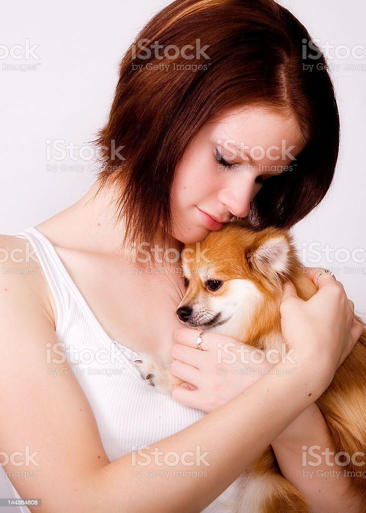 Snuggling with a Pup royalty-free stock photo
