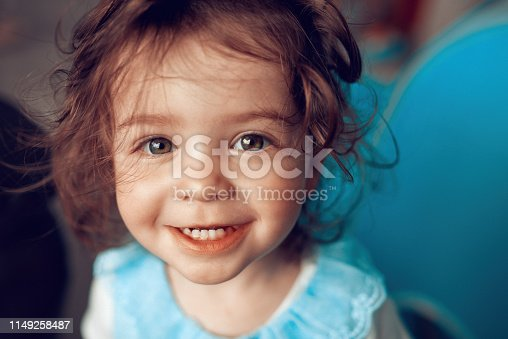 portrait of adorable baby girl looking at camera and enjoying playing.
