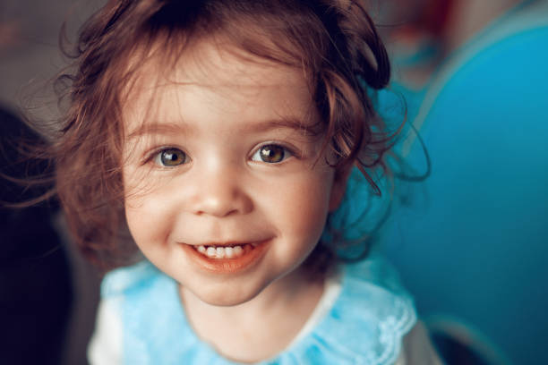 so cute and innocent smile portrait of adorable baby girl looking at camera and enjoying playing. baby girls stock pictures, royalty-free photos & images