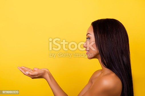 istock So cute and pure!  Close up cropped side shot of pretty charming latino, presenting dmonstrating new cream, mask or conditioner, so sensual, smooth and healthy, adorable and sexy 929990320