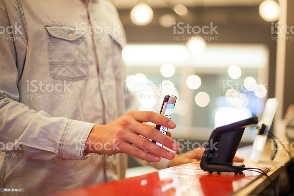 So easy to pay with my mobile phone stock photo
