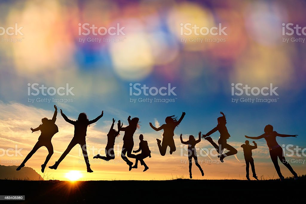 so energic friends jumping at sunset stock photo